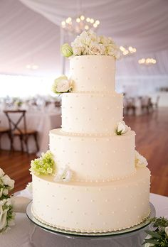 Brides: Four-Tiered White Cake with Piped Details. A four-tiered white wedding cake with piped dot details, created by Kennedy Confections.