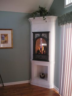 small bedroom fireplace. this is a great use of space. too bad its not real...