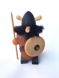 A personal favorite from my Etsy shop https://www.etsy.com/listing/252444019/wooden-viking-figure