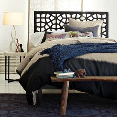 The Morocco Headboard from West Elm features a laser-cut design inspired by geometric Moroccan patterns