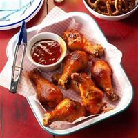 Saucy Barbecue Drumsticks Recipe -After searching for an out-of-this-world bottled barbecue sauce, I threw in the towel and stirred up my own with ketchup, honey, brown mustard—the works. —Kathleen Criddle, Lake Worth, Florida