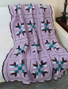 This afghan was fashioned after inspirational quilt patterns. It has a touch of country charm and possesses beautiful traditional details. Place over a chair or near a wood stove to add some warmth to your space.