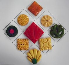 "9 carved vintage bakelite buttons featuring a variety of floral designs in this lot.  They range in size from 1 1/8"" to 2"" and are in very good to excellent condition.  SOLD $99.02"