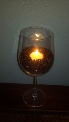 i made this using coffee beans and vanilla votives in a red wine glass. makes things smell so good!