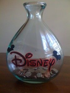 Disney Jar.  I love the shape of this one.  It would only be good for change though.  Unless you planned of breaking it to get the bills out...