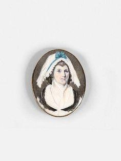 <b>Ecole anglaise de la fin du XVIIIe siècle</b>  <br /> <b>Femme à la coiffe au ruban bleu</b> <br /> Miniature de forme ovale <br />  <br /> Sur un fermoir de bracelet en métal doré <br /> h: 4,20w: 3,80cm <br />  <br /> Provenance : Collection Alphonse Kann, Saint-Germain-en-Laye ; <br /> Saisi en octobre 1940 et mis en dépôt au Jeu de Paume, ref. K...