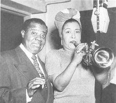Billie Holiday playing the horn with Louis Armstrong