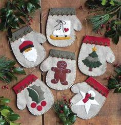 The Warm Hands Felt Christmas Ornament Kit from Rachel's of Greenfield makes 6 unique mitten ornaments. Kit includes felt, embroidery floss for embellishment, gold string for hanging, complete patterns, and illustrated instructions. Felt Christmas Ornaments, Noel Christmas, Primitive Christmas, Handmade Christmas, Snowman Ornaments, Winter Christmas, Felt Christmas Stockings, Christmas Runner, Ornament Crafts