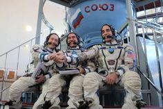 Pictured before qualification simulator runs at the Gagarin Cosmonaut Training Centre, near Moscow, Soyuz TMA-08M crewmen (from left) Aleksandr Misurkin, Pavel Vinogradov and Chris Cassidy clasp hands. Photo Credit: NASA