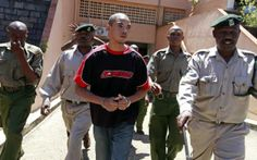 British citizen Jermaine Grant (C) is escorted into court for a hearing in the Kenyan coastal town of Mombasa May 9, 2012. REUTERS/Joseph Ok...