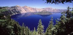 Crater Lake National Park, Oregon... the water reflects the sky like a giant mirror.  So peaceful.  So mysterious.