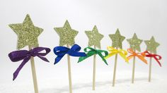 """This listing is for 12 cupcake toppers:  Single Sided Perfect for any occassion.   Star measure 1"""" (2.54 cm) across.  Non shed Gold Glitter - 160 gsm  Height of toothpick and heart is 3""""..."""
