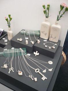 Vintage medicine bottles as display. Laura Pearcey - Boop Design - a lovely display of ceramic jewellery