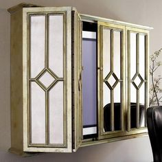 Plasma TV Entertainment Wall Cabinet Exclusively ours. Plasma TVs find a safe perch in this entertainment wall cabinet. Armoires Murales Tv, Tv Escondida, Tv Entertainment Wall, Deco Tv, Antique Mirror Glass, Antiqued Mirror, Tv Wall Cabinets, Kitchen Cabinets, Tv Covers