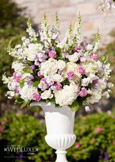 Church flower arrangement in white pot on plinth