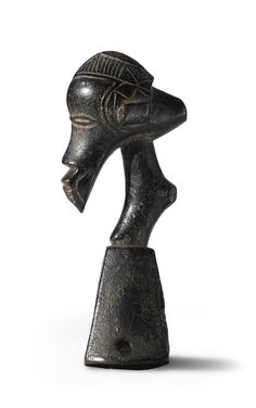 Guro Heddle Pulley, Ivory Coast. A masterful carving.