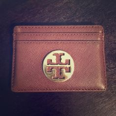 Tory Burch Card Holder Tory Burch dark brown card holder. 100% authentic. Shows some everyday wear. Tory Burch Other