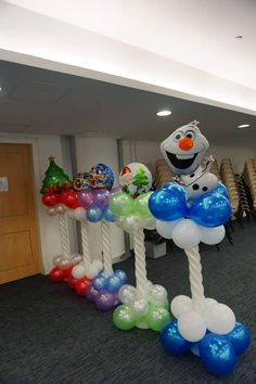 Wonderland Christmas Party Theme Is Ready With Snowman Santa Balloon Columns Christmas Tree Arch, Christmas Balloons, Christmas Party Themes, Indoor Christmas Decorations, Xmas Party, Balloon Decorations, Christmas Lights, Holiday Fun, Christmas Crafts