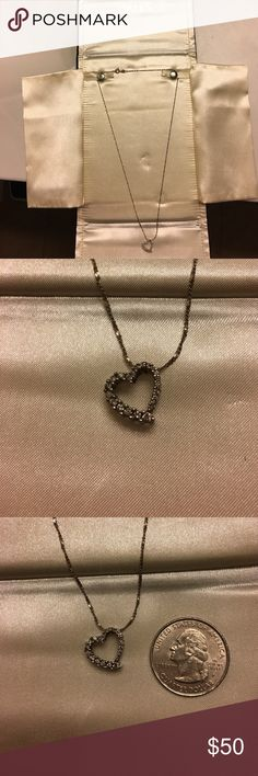 Diamond heart shaped pendant necklace Worn only a handful of times. On a 20 in sterling silver chain. Kept in box Zales Jewelry Necklaces
