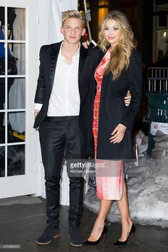 Musician Cody Simpson (L) and model Gigi Hadid attend Sports Illustrated Swimsuit 50th Anniversary Party at the Swimsuit Beach House on February 18, 2014 in New York City.
