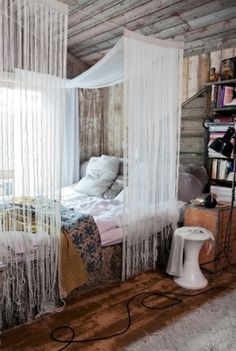LIkes: worn wood, light, mixed colors/patterns on bed (natural but not out of control), canopy that isn't confining, bed looks out window, books near the bed, cozy rug, trunk as table    Dislikes:shiny end table, cord across floor, lamp too far from bed, window might be a bother in the morning