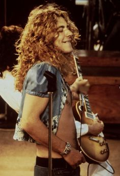 Robert Plant. Such a great face here. Which is to say nothing of the midriff, or hair.