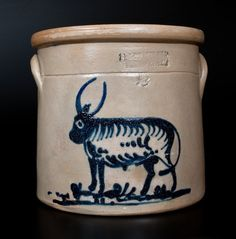 "Sold $650 Very Rare Two-Gallon Stoneware Crock with Cobalt Bull Decoration, Stamped ""J.A. & C.W. UNDERWOOD / FORT EDWARD, NY,"" circa 1865-1867, cylindrical crock with tooled shoulder, semi-rounded rim, and applied lug handles, decorated with a folky slip-trailed design of a standing bull with long horns and heavily-striped body, standing in a pasture. One of a few examples of Fort Edward stoneware known bearing this figural design. Significant restoration to exfoliation throughout crock, inc"