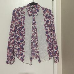 White, pink and purple floral button down shirt The design is kind of a floral paisley. Only worn a few times. Absolutely gorgeous. Tops Button Down Shirts