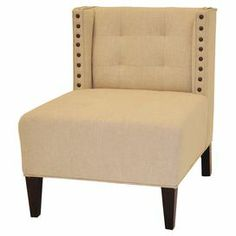 """Slipper chair in natural with a tufted back and nailhead trim.  Product: ChairConstruction Material: Wood and fabricColor: NaturalDimensions: 35"""" H x 28"""" W x 34"""" D"""