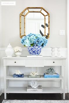 🌟Tante S!fr@ loves this📌🌟Freshen up your spring entryway decorating with a large blue hydrangea arrangement, coral sculptures, design books and white accessories. Grey And White Hallway, Grey Dining Room Chairs, Entryway Decor, Bedroom Decor, Gray Console Table, Coffee Table Styling, Console Styling, Hydrangea Arrangements, Decorating Bookshelves