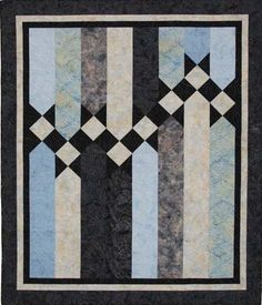 """61"""" x 73"""" Generous lap size quilt , with large, simple pieces make this quilt not only a great beginner quilt, but aesthetically appealing-and a terrific option for a male oriented project."""