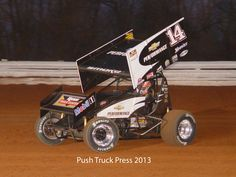 Tony Stewart gassing a sprint car at Williams Grove Speedway in Pennsylvania.