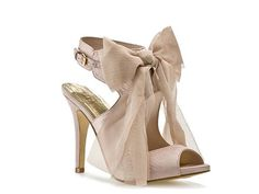 These shoes would be a great complement to the easy flow of the Vera Wang dress. The soft bow will work well with the soft, flowy feel of the dress.