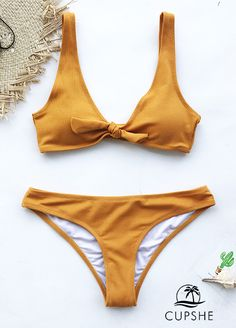New Color and New Style! Show you the most trendy style of beach fashion! Cupshe Art Treasure Solid Bikini Set features classical bowknot at front! Enjoy a better vacation! Free shipping & Shop Now!