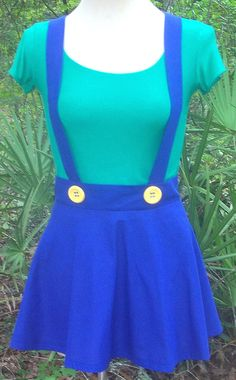Channel Luigis feminine side! This is a made-to-order custom adult female Luigi costume for cosplay gaming conventions, Halloween or any time you feel like dressing up like Luigi from the Super Mario Bros game. Also available in Mario colors and in any size from petite to plus size. Luigis colors are kelly green and cobalt blue with big yellow buttons. Mario comes with a cherry red shirt. A great costume for anyone who loves the video games based on these characters!  The first 4 pictures…