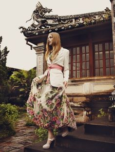 She carries fragrant blossoms in the folds of her skirt, the garden dances in her fabrics. We like that her outfit is decidedly NOT oriental, yet her surroundings lend a sacred stillness to the subtle quietude of her clothing.