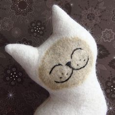 smile :)   This piece isn't needle felted but is made of re-purposed wool. I'm not familiar with all the processes in making this but it's too cute ~ ! ~