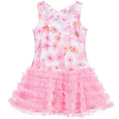 Girls pink floral dress by Kate Mack & Biscotti. Made in stretch cotton jersey, it is sleeveless, with a fitted bodice and a tulle frill skirt. The fabric at the front is spotted and has floral appliqué, with jewel centres. The back has cross-shaped straps, with a floral print.
