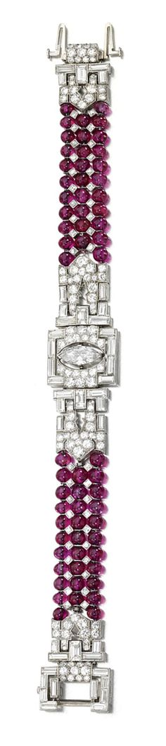 RUBY BEAD AND DIAMOND BRACELET, CIRCA 1935.  The three rows of ruby beads embellished at the centre with a geometric pattern set with marquise-shaped, baguette, circular- and single-cut diamonds, length approximately 182mm.