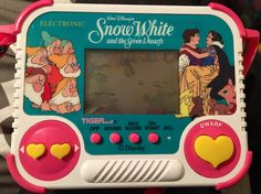 Now selling: SNOW WHITE DISNEY Handheld Game Complete w/Pink Carrying Strap, 1990 Vintage Video Game by Tiger El... https://www.etsy.com/listing/508462789/snow-white-disney-handheld-game-complete?utm_campaign=crowdfire&utm_content=crowdfire&utm_medium=social&utm_source=pinterest