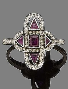 Art Deco ruby and diamond ring, circa 1920. The quatrefoil-shaped plaque, pierced and collet-set with step and triangular-cut rubies, surrounded by rose-cut diamonds, to similarly-cut diamond shoulders. (ETS)