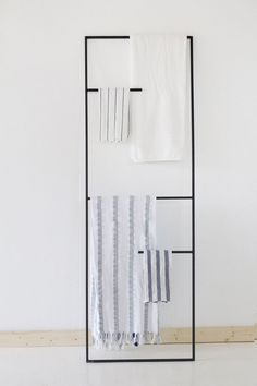 If wall hooks aren't your thing, you could use a metal leaning ladder instead, to display your towels and help them dry faster. The dark metal of this one helps to create a more minimalist masculine feel.