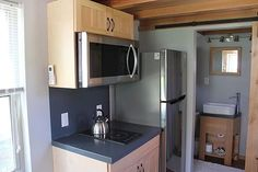 Visit an unusual tiny house with a very clever design: It boasts 2 spacious bedrooms