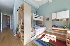 Tavin's room was built around a twin over full bed with a trundle. We love this design option for family guests! We built an open cabinet that divides the room making two unique spaces. This offers a nice transition for privacy. #casakids #custom #kidsroom #bunkbed
