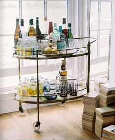 love the small home bar if you can't afford to get a custom made one. would be perfect for apartment living.