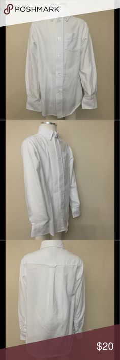NWOT Boys Chaps School Uniform Shirt size 5 You are looking at a NWOT boys Chaps school uniform oxford button down shirt size 5 in white. It features a classic button down front, long sleeves with button cuffs, a front pocket on the left chest, and a button down collar. This is a very versatile shirt since it can be paired with any type of pants, ranging from jeans for a more laid back style to a pair of chinos for a more dressy appearance. Chaps Shirts & Tops Button Down Shirts
