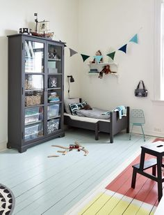 This is the coolest idea: painting an old wooden floor into three different colored parts for a shared children's room!