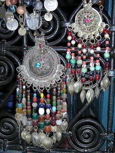 kuchi pendants with colorful beadwork added.