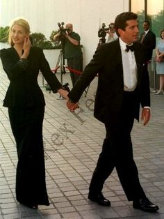 Carolyn Bessette Kennedy and John John. I miss them-theres such a huge void in the world is without them :-(
