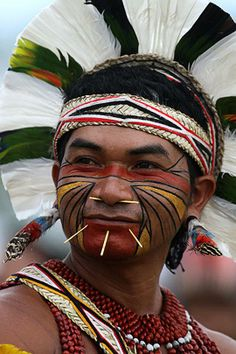 A Pataxo Indian at the Indigenous Games on the island of Porto Real in the city of Porto Nacional, Brazil., photo by Eraldo Peres for AP - Pixdaus